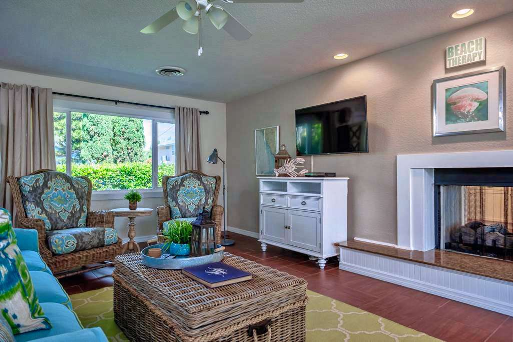 Relax in the Bright & Cheery Newly Remodeled Living Room.