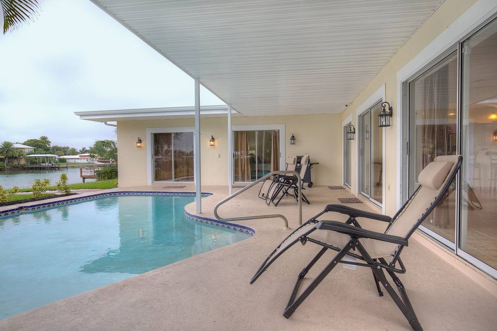 Enjoy the Waterfront View from Your Pool Patio.