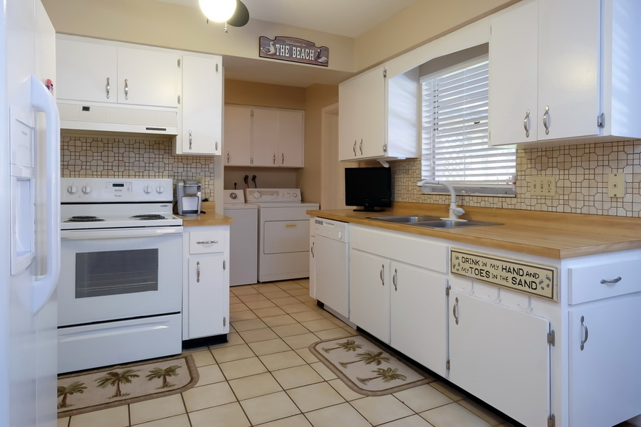 Bright Kitchen with Adjoining Laundry Room.