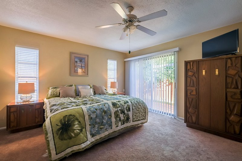 Master Bedroom with Direct Access to Pool Area.