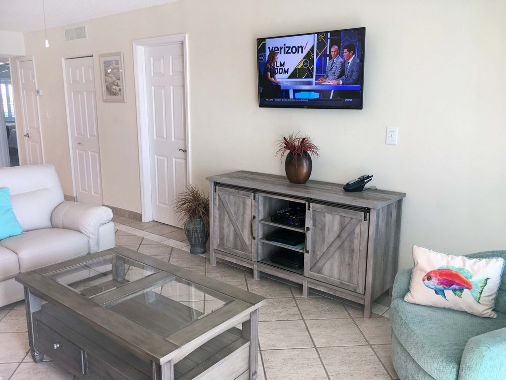 Living Room with Mounted Flat Screen